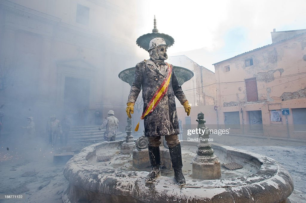 A Reveller takes part in the battle of 'Enfarinats', a flour fight in celebration of the Els Enfarinats festival on December 28, 2012 in Ibi, Spain. Citizens of Ibi annually celebrate the festival with a battle using flour, eggs and firecrackers. The battle takes place between two groups, a group of married men called 'Els Enfarinats' which take the control of the village for one day pronouncing a whole of ridiculous laws and fining the citizens that infringe them and a group called 'La Oposicio' which try to restore order. At the end of the day the money collected from the fines is donated to charitable causes in the village. The festival has been celebrated since 1981 after the town of Ibi recovered the tradition but the origins remain unknown.Ê
