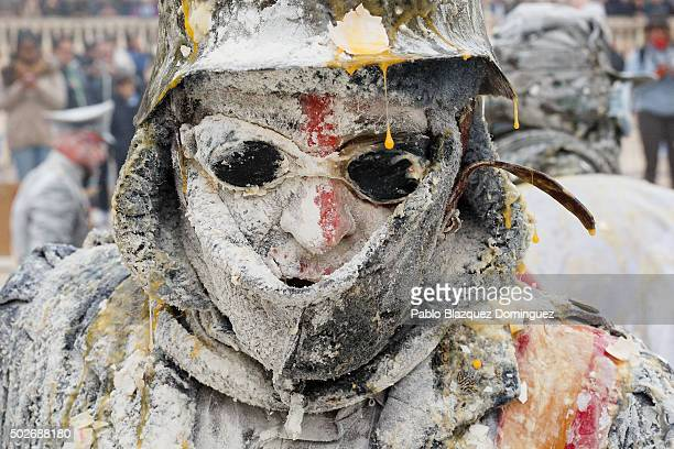 A reveller takes part in the battle of 'Enfarinats' a flour fight in celebration of the Els Enfarinats festival on December 28 2015 in Ibi Spain...