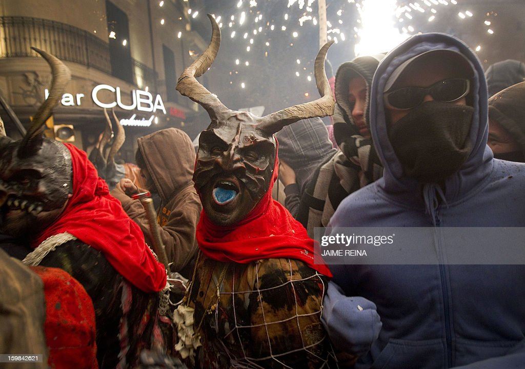 A reveller wearing a demon costume takes part in the traditional festival of 'Correfoc' in Palma de Mallorca on January 21 2013 Participants dress as...