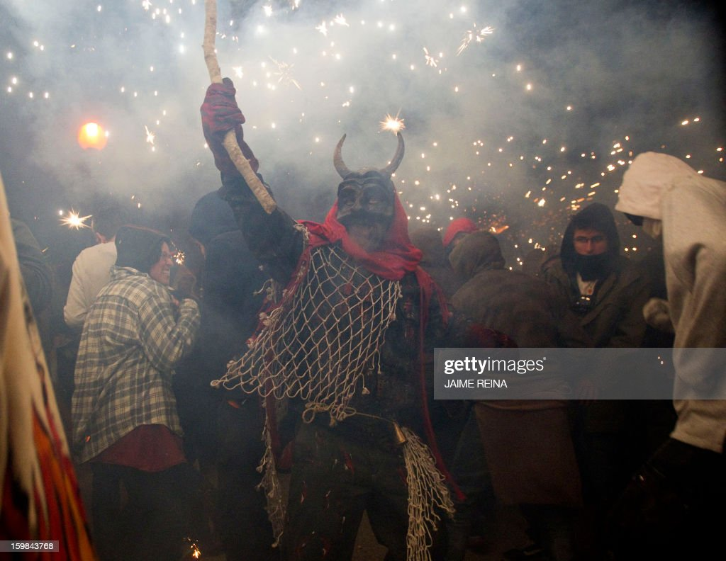 A reveller wearing a demon costume takes part in the traditional festival of 'Correfoc' in Palma de Mallorca, on January 21, 2013. Participants dress as demons and devils and move through the streets scaring people with fire and fireworks. AFP PHOTO / JAIME REINA