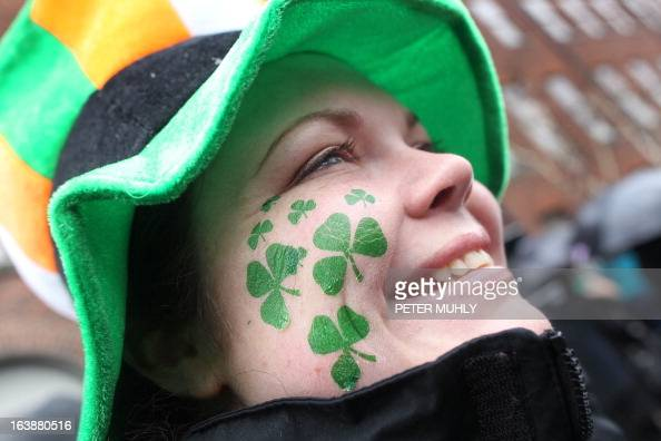 A reveller with shamrocks painted on her face attends St Patrick's Day festivities in Dublin on March 17 2013 More than 100 parades are being held...