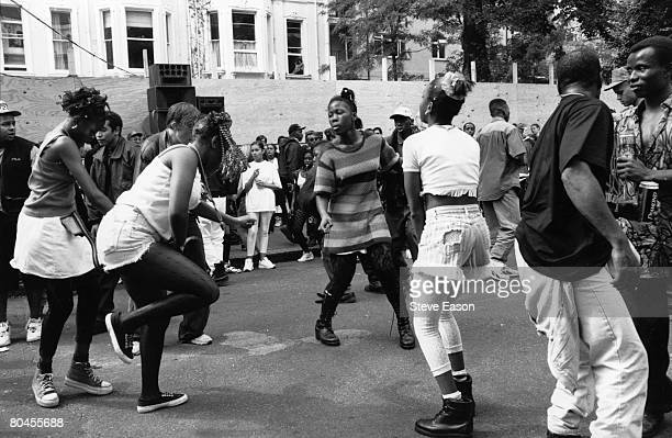 Revellers at the Notting Hill Carnival London dancing in the streets to music from a sound system August 1994