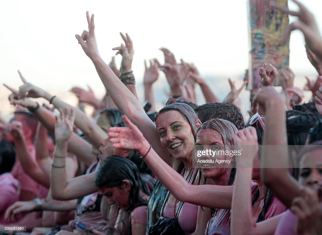 Revellers attend 'Life in Color Kingdom' - The Worlds Largest Paint Party at Izmir Arena in Turkey's Izmir on May 28, 2016.