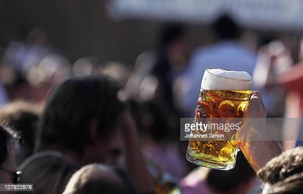 Revellers attend the Schottenhamel beer tent during the last day of Oktoberfest beer festival on October 2 2011 in Munich Germany