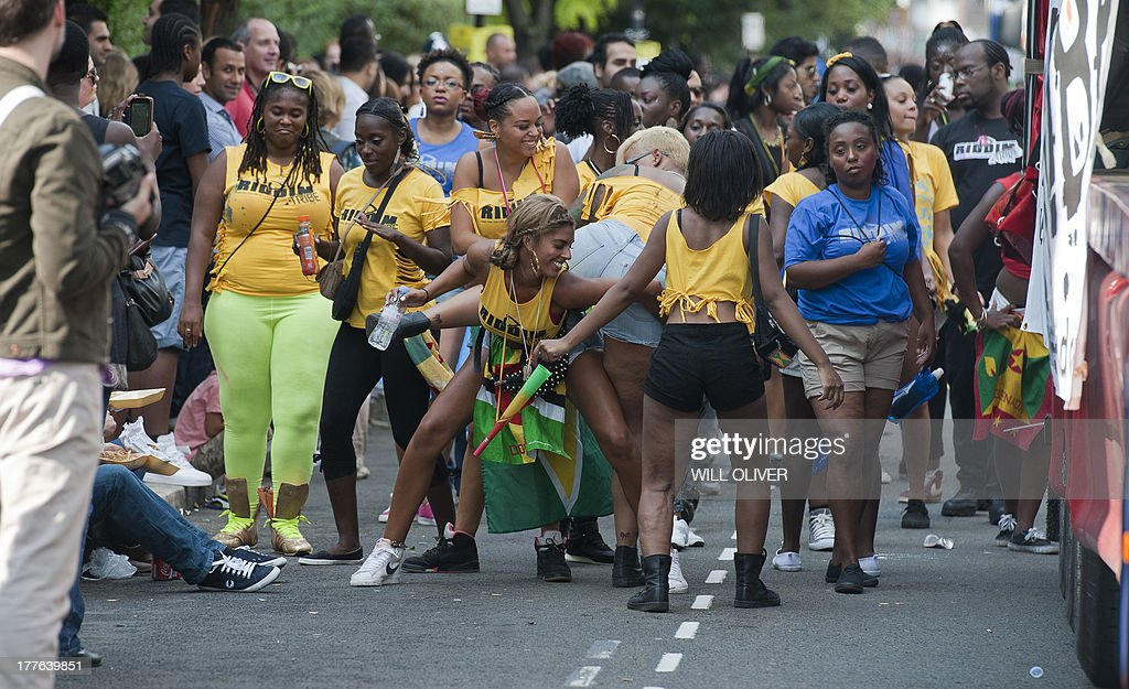 Revellers attending the first day of the Notting Hill Carnival in west London on August 25, 2013. Running over two days, the Caribbean carnival puts on a Kid's day on the Sunday when costume prizes are awarded and a 'main parade' day on the Monday.