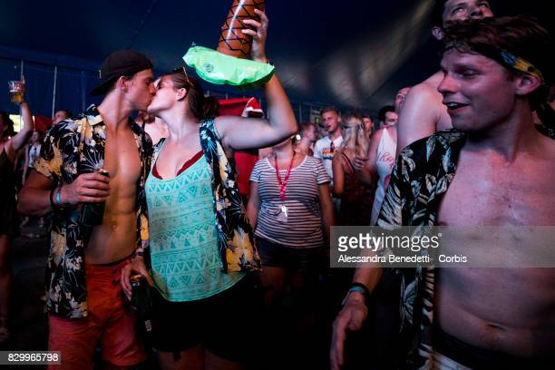 Revellers attends the 25th edition of the Sziget Festival on August 10 2017 in Budapest Hungary The Sziget Festival one of the largest music and...