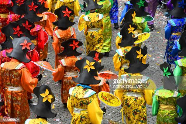 Revellers celebrate carnival during the traditional 'Rose Monday' carnival parade in Duesseldorf western Germany on February 27 2017 / AFP / PATRIK...