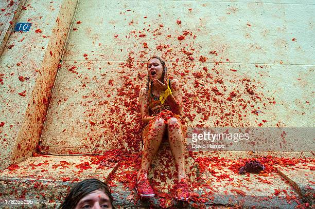 Revellers celebrate covered by tomato pulp while participating the annual Tomatina festival on August 28 2013 in Bunol Spain An estimated 20000...