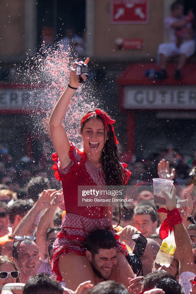 Revellers celebrate during the opening day or 'Chupinazo', of the San Fermin Running of the Bulls fiesta on July 6, 2013 in Pamplona, Spain. The annual Fiesta de San Fermin, made famous by the 1926 novel of US writer Ernest Hemmingway entitled 'The Sun Also Rises', involves the running of the bulls through the historic heart of Pamplona, this year for nine days from July 6-14.