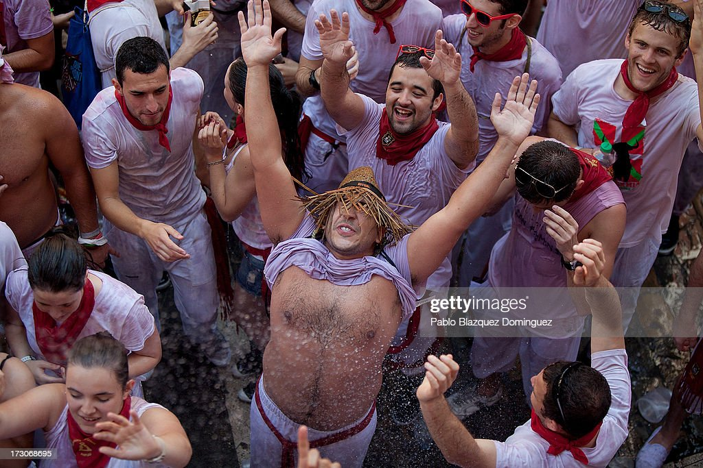Revellers celebrate during the opening day or 'Chupinazo', of the San Fermin Running of the Bulls fiesta on July 6, 2013 in Pamplona, Spain. The annual Fiesta de San Fermin, made famous by the 1926 novel of US writer Ernest Hemmingway entitled 'The Sun Also Rises,' involves the running of the bulls through the historic heart of Pamplona, this year for nine days from July 6-14.