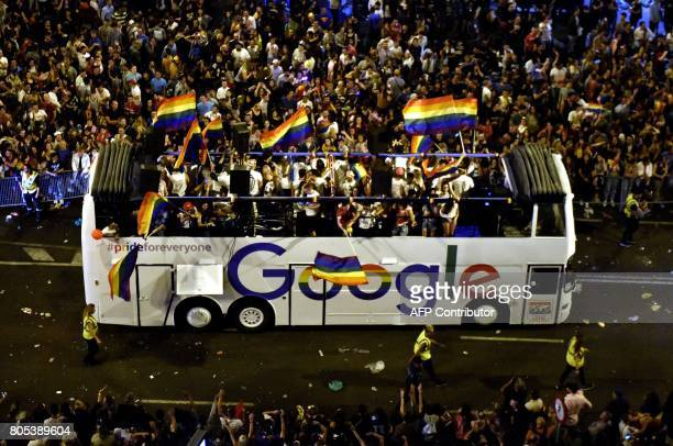 Revellers celebrate on the Google float at Cibeles square during the WorldPride 2017 parade in Madrid on July 1 2017 Authorities and organisers...