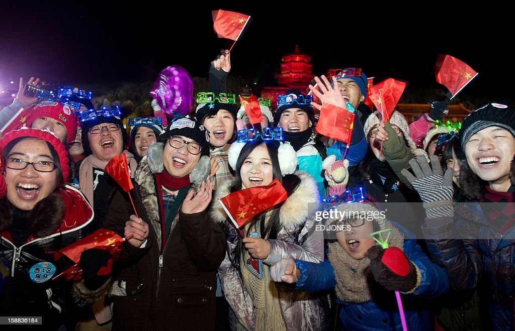 Revellers celebrate the new year during a count-down event at the Summer Palace in Beijing on January 1, 2013. AFP PHOTO / Ed Jones