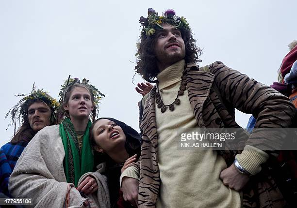 Revellers celebrate the pagan festival of Summer Solstice at Stonehenge in Wiltshire southern England on June 21 2015 The festival which dates back...