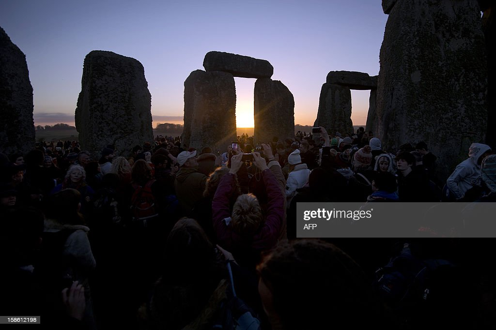 Revellers celebrate the pagan festival of 'Winter Solstice' at Stonehenge in Wiltshire in southern England on December 21, 2012.