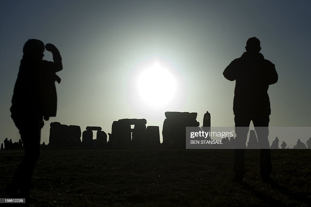 Revellers celebrate the pagan festival of 'Winter Solstice' at Stonehenge in Wiltshire in southern England on December 21, 2012. AFP PHOTO/BEN STANSALL