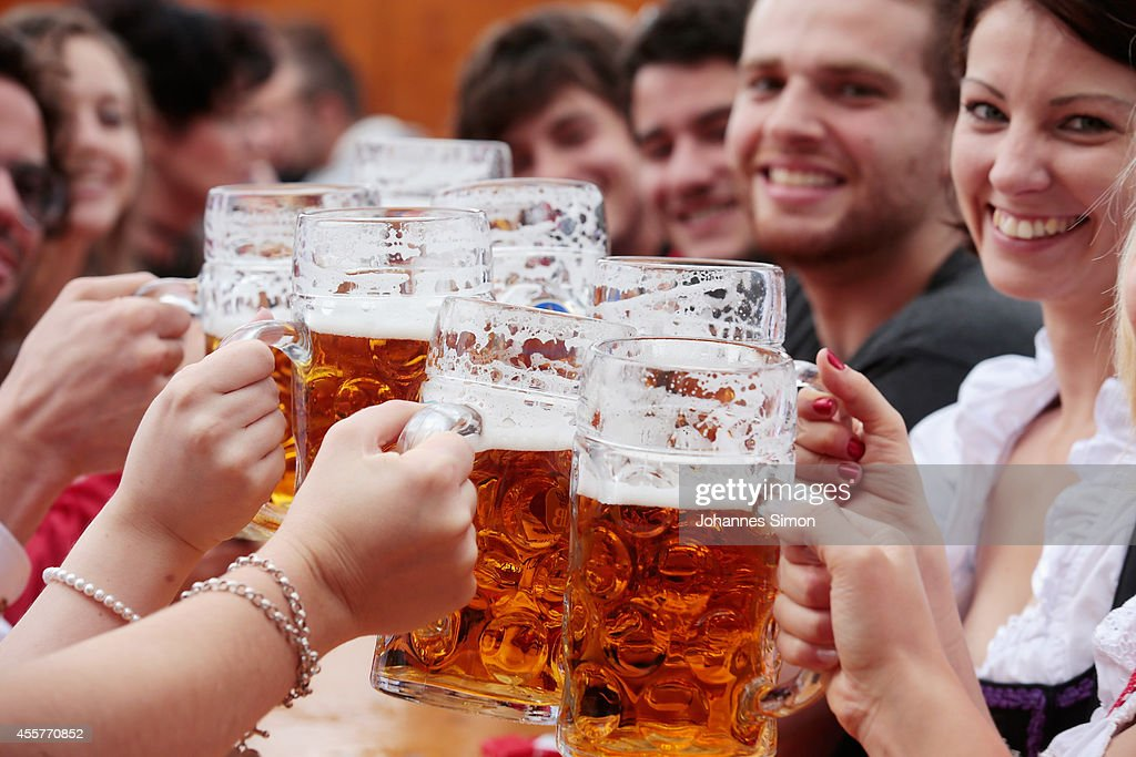 Revellers cheer with beer mugs at Hofbraeuhaus beer tent during the opening day of the 2014 Oktoberfest on September 20 2014 in Munich Germany The...