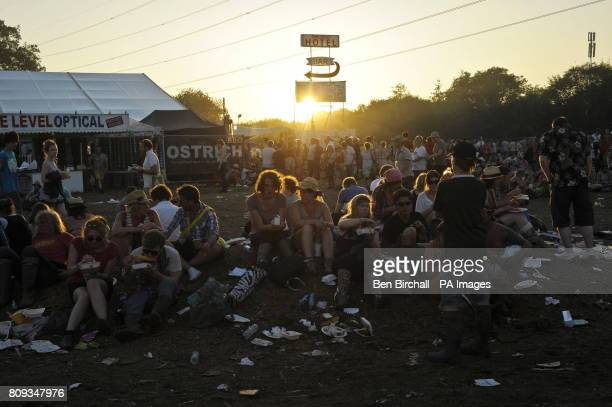 Revellers chill out and enjoy the last rays of sunshine on Sunday evening at Glastonbury festival Worthy Farm Pilton as the headline acts prepare to...