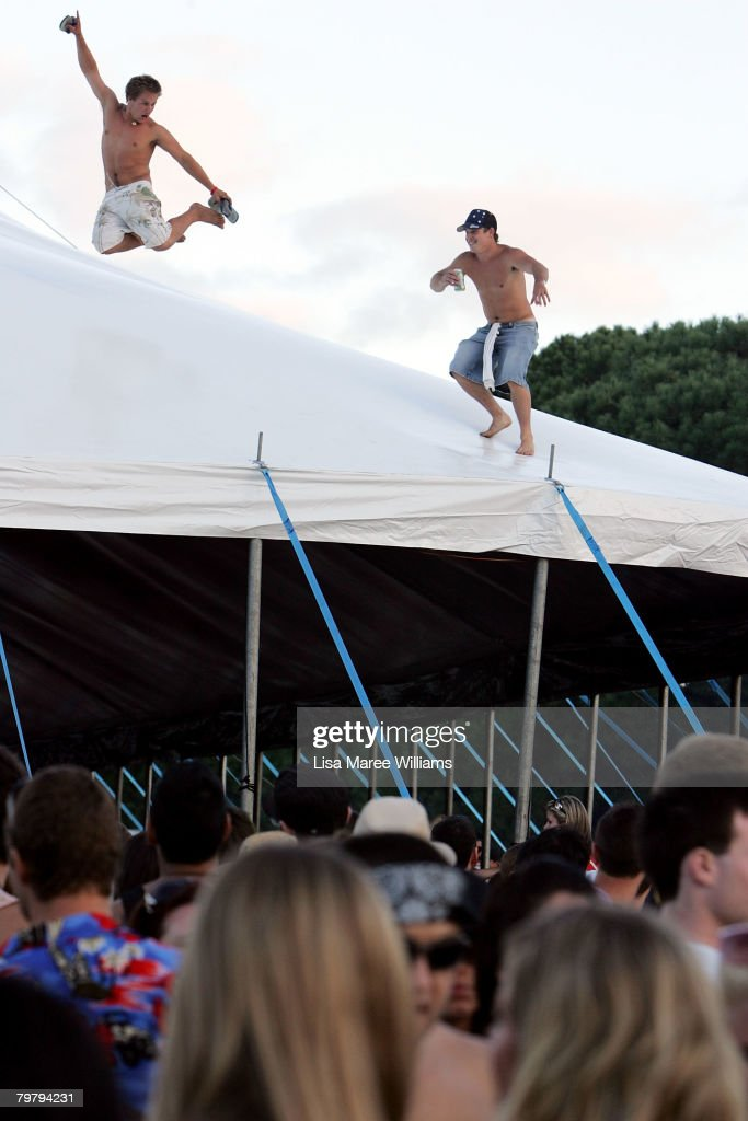Revellers climb on top of a tent during the Good Vibrations Festival in Centennial Park on February 16, 2008 in Sydney, Australia.