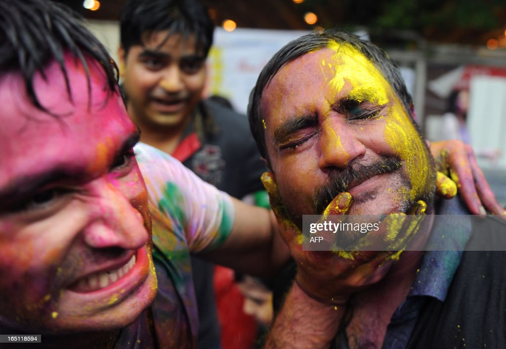 Revellers cover one another in coloured powders as they celebrate 'Holi' in Hong Kong on March 31, 2013. Holi, the festival of colours where people smear each other with coloured powder and water, is celebrated by Hindus across the world.