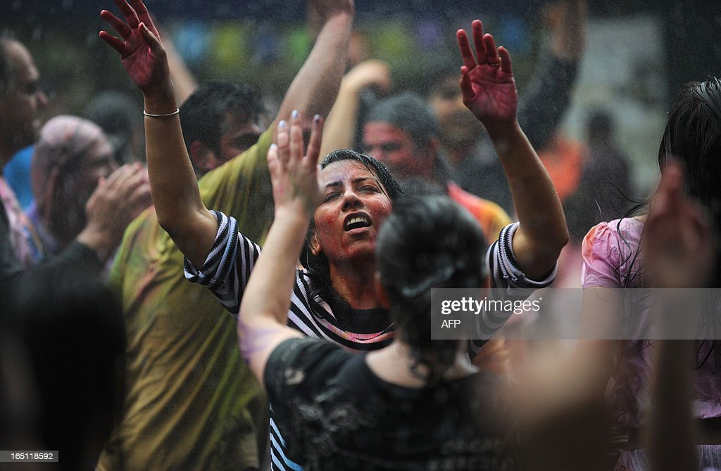 Revellers covered in coloured powders and water celebrate 'Holi' in Hong Kong on March 31, 2013. Holi, the festival of colours where people smear each other with coloured powder and water, is celebrated by Hindus across the world.