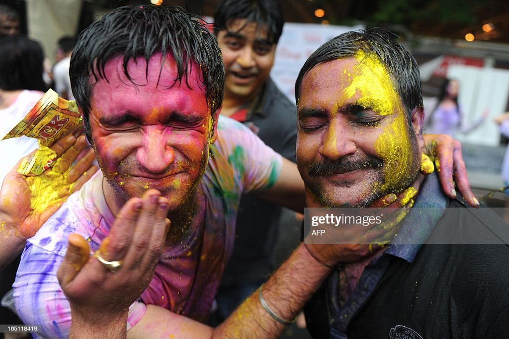 Revellers covered in coloured powders celebrate 'Holi' in Hong Kong on March 31, 2013. Holi, the festival of colours where people smear each other with coloured powder and water, is celebrated by Hindus across the world.