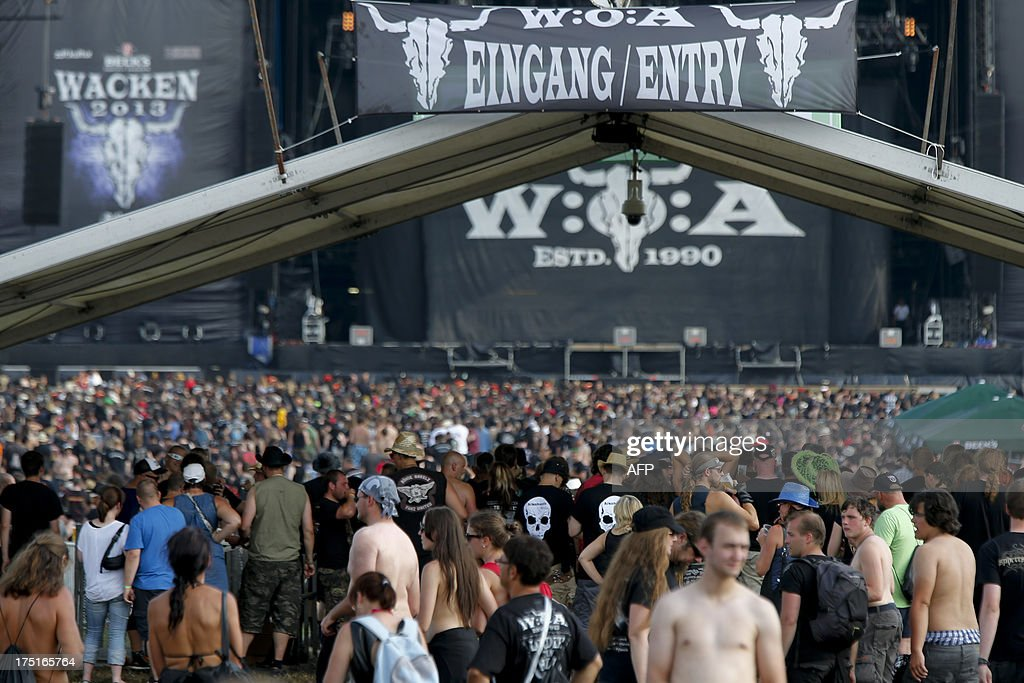 Revellers crowd the festival site during the 24th heavy metal Wacken Open Air (WOA) Festival 2013 in Wacken, northern Germany on August 1, 2013. With some 80,000 festival visitors it attracts all kinds of metal music fans, such as fans of black metal, death metal, power metal, thrash metal, gothic metal, folk metal and even metalcore, nu metal and hard rock from around the world.