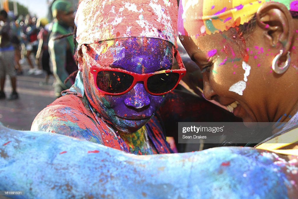 Revellers dance and paint themselves during the J´ouvert Festival on February 11, 2013 in Port of Spain, Trinidad.