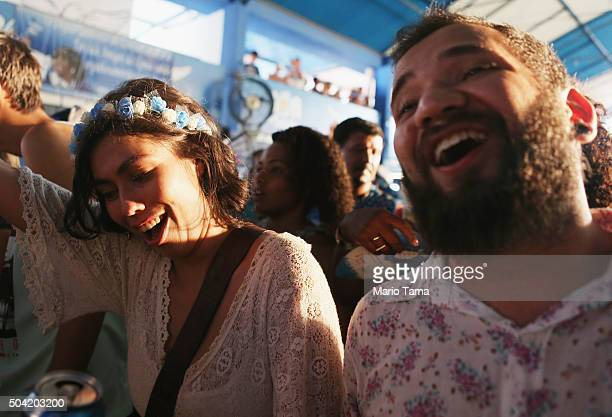 Revellers dance at a traditional samba and feijoada party held at the Portela Samba School considered one of the oldest samba schools in Rio during...