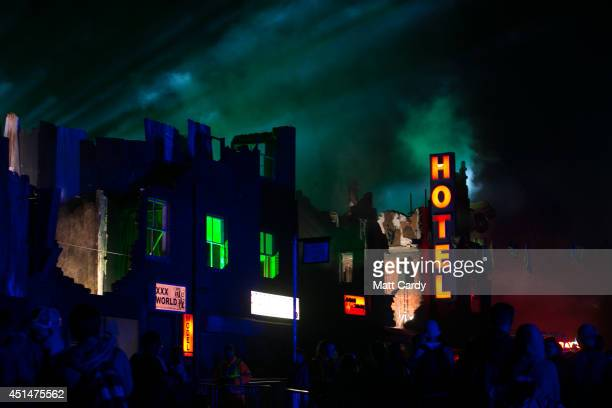 Revellers dance at an outdoor venue at Block 9 at Worthy Farm in Pilton during the 2014 Glastonbury Festival on June 29 2014 in Glastonbury England...