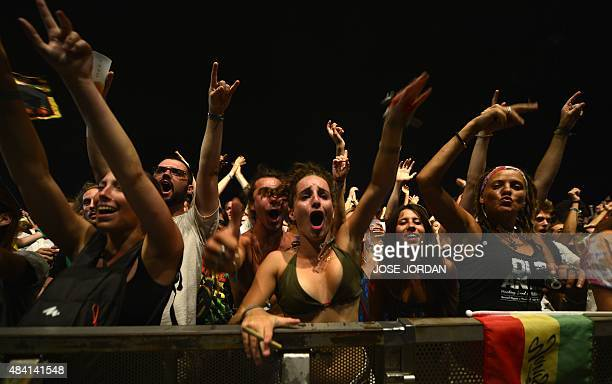 Revellers dance during a concert at the Rototom Sunsplash Reggae festival in Benicassim Castellon province on August 14 2015 Rototom runs from August...