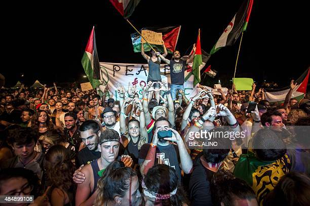 Revellers dance during a concert of Jewish American singer Matisyahu at the Rototom Sunsplash Reggae festival in Benicassim on August 22 2015...