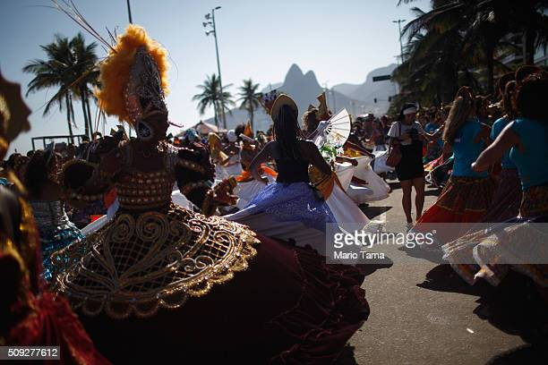 Revellers dance during Carnival celebrations at the Rio Maracatu 'bloco' or street parade on February 9 2016 in Rio de Janeiro Brazil Festivities...