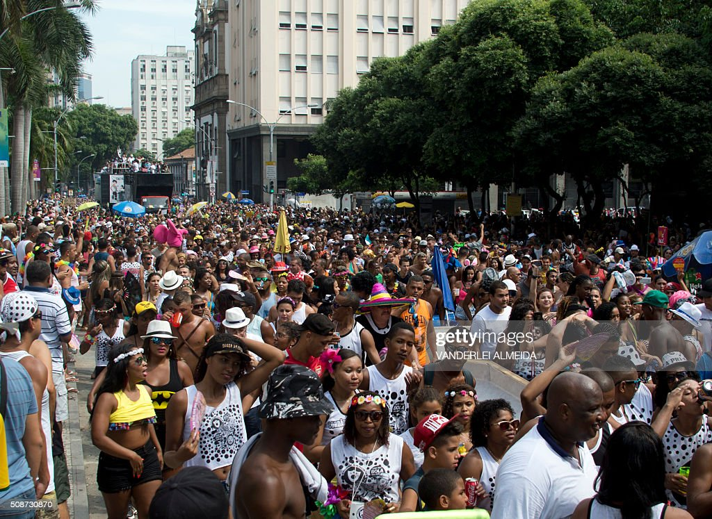 Revellers dance during the traditional 'Cordao do Bola Preta' carnival band parade, in downtown Rio de Janeiro, Brazil, on February 6, 2016. Though Brazil's carnival will reach a fever pitch Sunday with Rio's flamboyant float competition, Brazilians have already started banging drums, dancing and singing in the sultry streets of Rio and across the country before the official start of what Brazilians dub 'The Greatest Show on Earth. AFP PHOTO / VANDERLEI ALMEIDA / AFP / VANDERLEI ALMEIDA