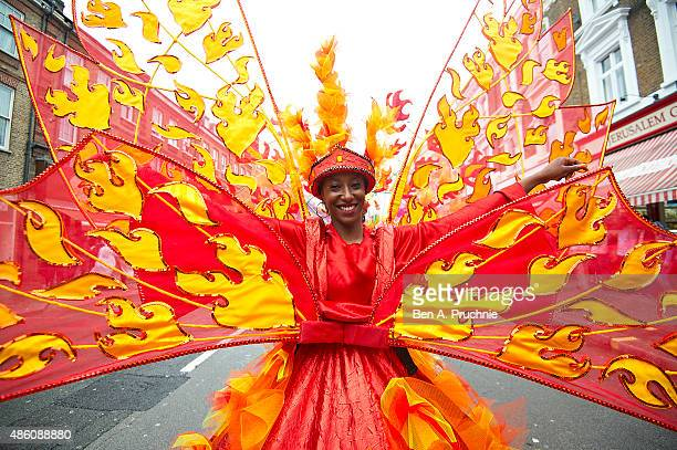 Revellers dance on the street during the parade at Notting Hill Carnival on August 31 2015 in London England The Carnival the largest in Europe is a...