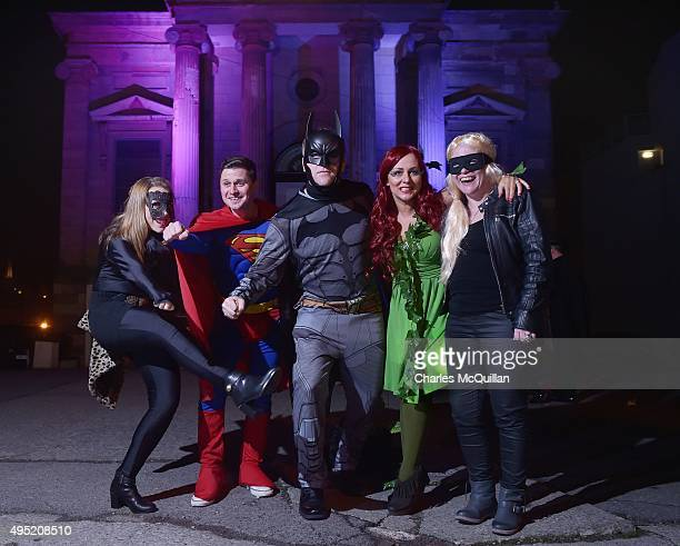 Revellers dressed as various superheroes pose for photographs as they arrive for a Gothic Ball taking place inside a former church on October 31 2015...