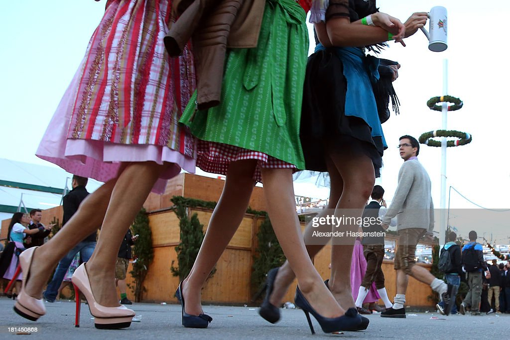 Revellers dressed in traditional Bavarian clothing `Dirndl` walk over the Theresienwiese during day 1 of the Oktoberfest 2013 beer festival at Theresienwiese on September 21, 2013 in Munich, Germany. The Munich Oktoberfest, which this year will run from September 21 through October 6, is the world's largest beer fest and draws millions of visitors.