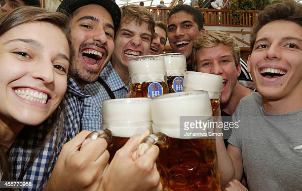 Revellers enjoy drinking beer at Hofbraeuhaus beer tent during the opening day of the 2014 Oktoberfest on September 20 2014 in Munich Germany The...
