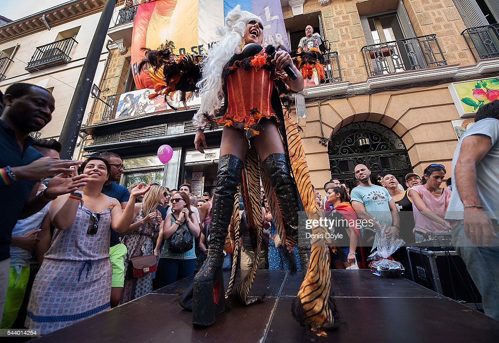 Revellers enjoy the atmosphere during the 2016 Madrid Gay Pride week on June 30, 2016 in Madrid, Spain. Hundreds of thousands of revellers celebrate the Gay Pride week in Madrid, one of the biggest in Europe.