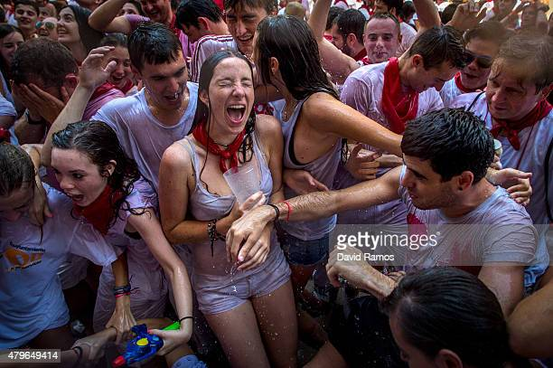Revellers enjoy the atmosphere during the opening day or 'Chupinazo' of the San Fermin Running of the Bulls fiesta on July 6 2015 in Pamplona Spain...