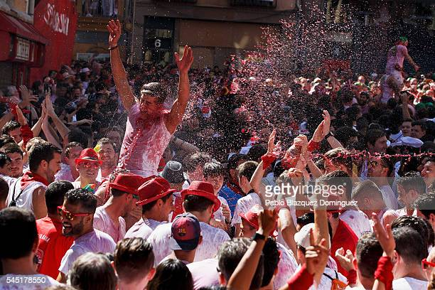 Revellers enjoy the atmosphere during the opening day or 'Chupinazo' of the San Fermin Running of the Bulls fiesta on August 6 2016 in Pamplona Spain...