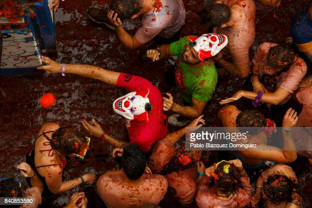 Revellers enjoy the atmosphere in tomato pulp while participating the annual Tomatina festival on August 30 2017 in Bunol Spain An estimated 22000...