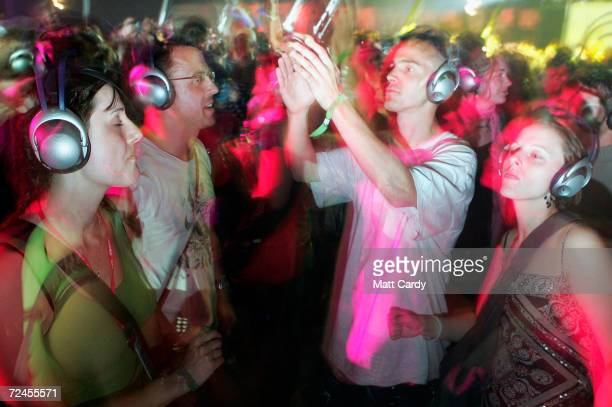Revellers enjoy the silent allnight disco in the Dance Tent on the second day of the Glastonbury Music Festival 2005 at Worthy Farm Pilton on June 25...