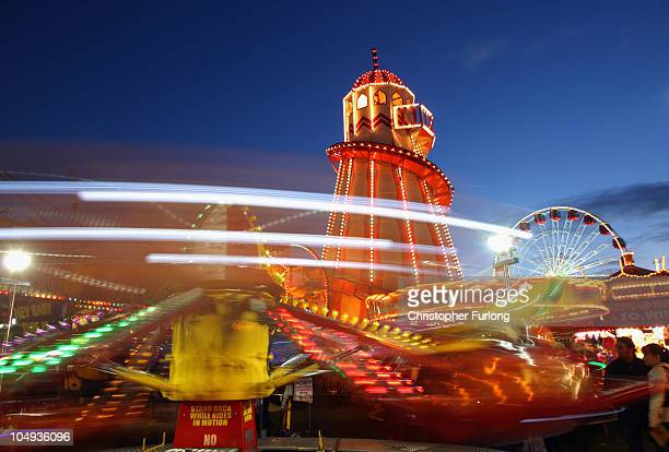 Revellers enjoy the thrills and fun of the traditional fair ground at the annual Goose Fair on October 6 2010 in Nottingham England The Goose Fair is...
