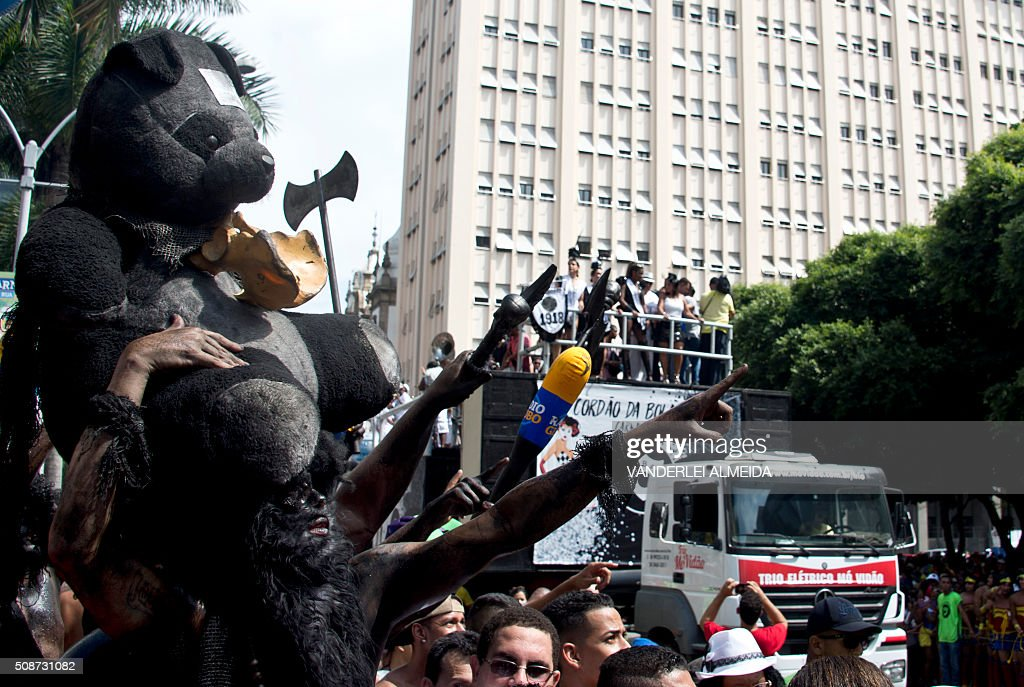 Revellers enjoy the traditional 'Cordao do Bola Preta' carnival band parade, in downtown Rio de Janeiro, Brazil, on February 6, 2016. Though Brazil's carnival will reach a fever pitch Sunday with Rio's flamboyant float competition, Brazilians have already started banging drums, dancing and singing in the sultry streets of Rio and across the country before the official start of what Brazilians dub 'The Greatest Show on Earth. AFP PHOTO / VANDERLEI ALMEIDA / AFP / VANDERLEI ALMEIDA