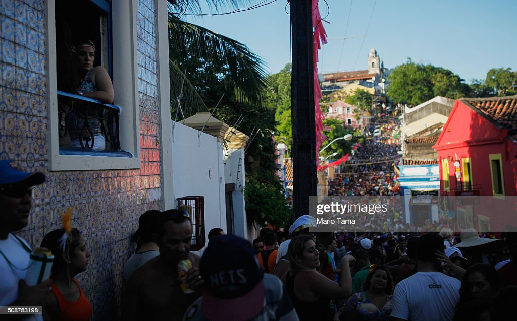 Revellers gather during a street parade, or 'bloco', during Carnival celebrations on February 6, 2016 in Olinda, Pernambuco state, Brazil. Olinda's sister city of Recife is being called the epicenter of the Zika virus outbreak. Carnival celebrations are continuing normally.