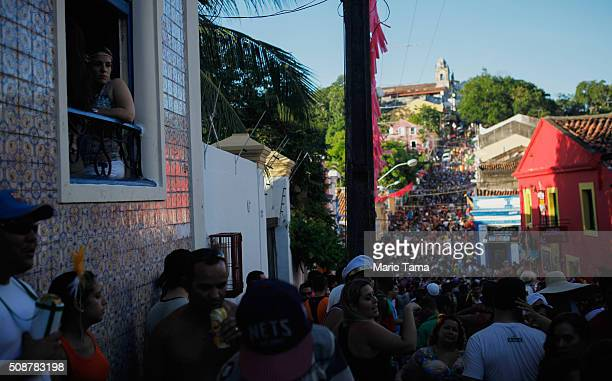 Revellers gather during a street parade or 'bloco' during Carnival celebrations on February 6 2016 in Olinda Pernambuco state Brazil Olinda's sister...