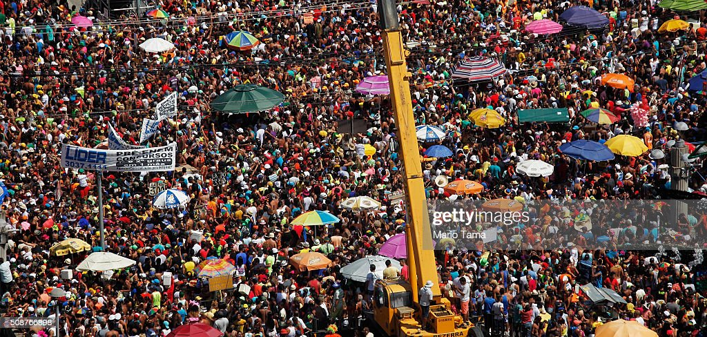 Revellers gather during Carnival celebrations on February 6, 2016 in Recife, Pernambuco state, Brazil. Officials say as many as 100,000 people may have already been exposed to the Zika virus in Recife, which is being called the epicenter of the Zika outbreak, although most people never develop symptoms. Streets were packed in spite of concerns over the spreading of the Zika virus.