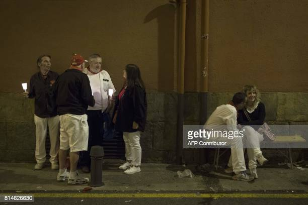 Revellers hold candles after the singing of 'Pobre de Mi' which marks the end of the San Fermin festival in Pamplona early on July 15 2017 00 am...