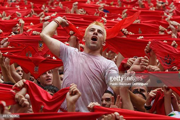 Revellers hold up their red handkerchiefs during the opening and the firing of the 'Chupinazo' rocket which starts the 2014 Festival of the San...