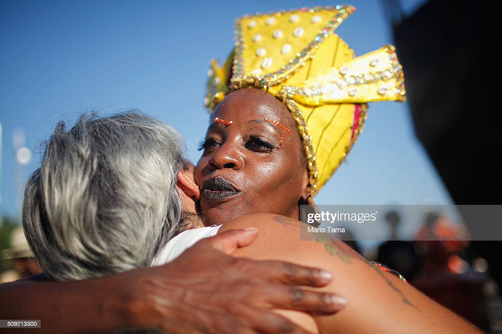 Revellers hug during Carnival celebrations at the Rio Maracatu 'bloco', or street parade, on February 9, 2016 in Rio de Janeiro, Brazil. Festivities have continued throughout Brazil for Carnival in spite of the threat of the Zika virus. Today is the last official day of Carnival.
